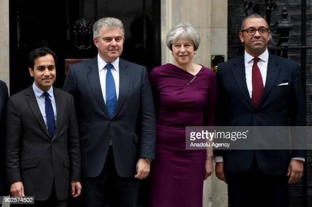 Prime Minister Theresa May poses with Brandon Lewis James Cleverly at 10 Downing street as she reshuffles her cabinet in London United Kingdom on...