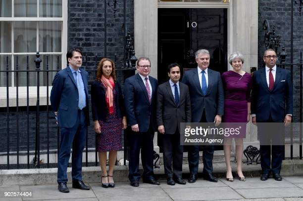 Prime Minister Theresa May poses with Brandon Lewis James Cleverly and others at 10 Downing street as she reshuffles her cabinet in London United...