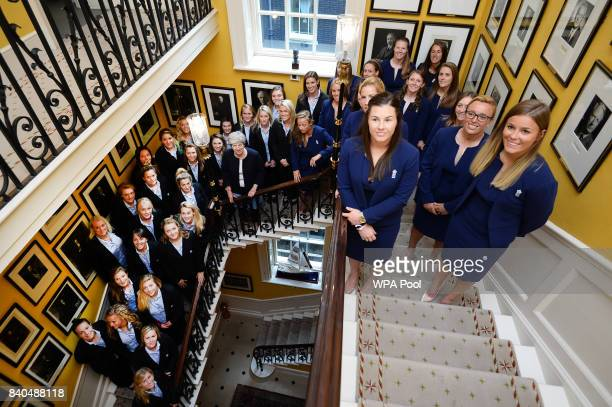 Prime Minister Theresa May poses with members of the England Women's Cricket and Rugby teams at a reception at 10 Downing Street on August 29 2017 in...