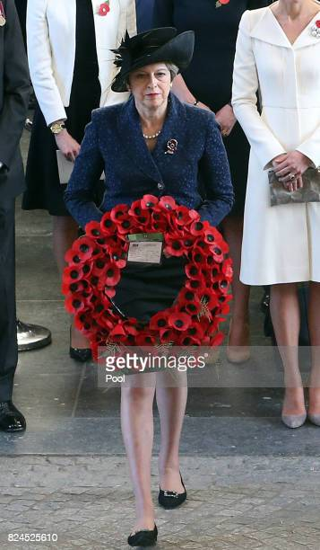 Prime Minister Theresa May prepares to lay a wreath during the official commemorations marking the 100th anniversary of the Battle of Passchendaele...