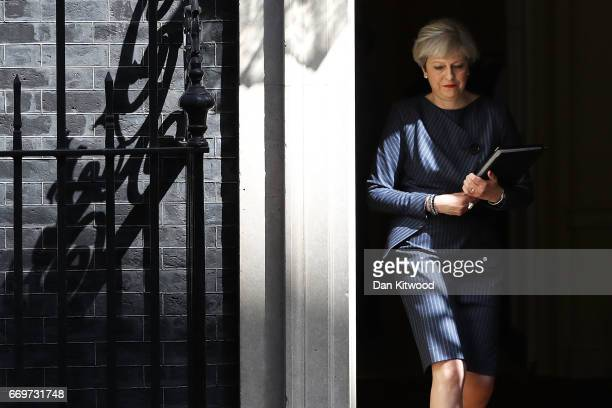 Prime Minister Theresa May prepares to make a statement to the nation in Downing Street on April 18, 2017 in London, United Kingdom. The Prime...