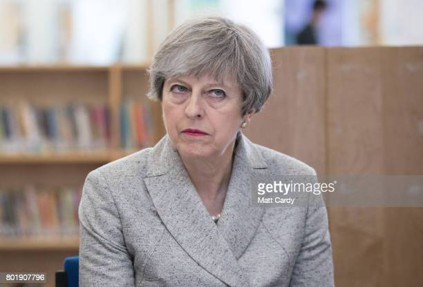 Prime Minister Theresa May sits in on a session for teachers receiving training in mental health support at Orchard School on June 27 2017 in Bristol...