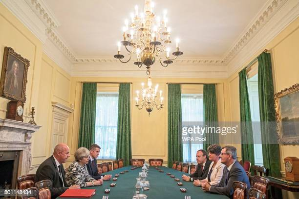 Prime Minister Theresa May sits with First Secretary of State Damian Green , and Parliamentary Secretary to the Treasury, and Chief Whip, Gavin...