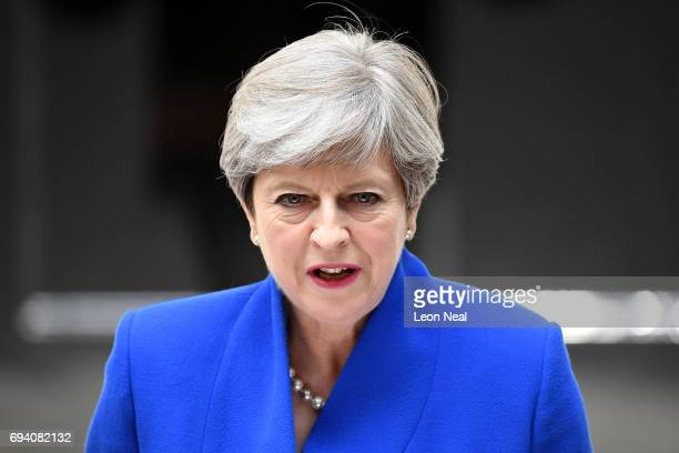 Prime Minister Theresa May speaks outside 10 Downing Street after returning from Buckingham Palace on June 9, 2017 in London, England. After a snap...