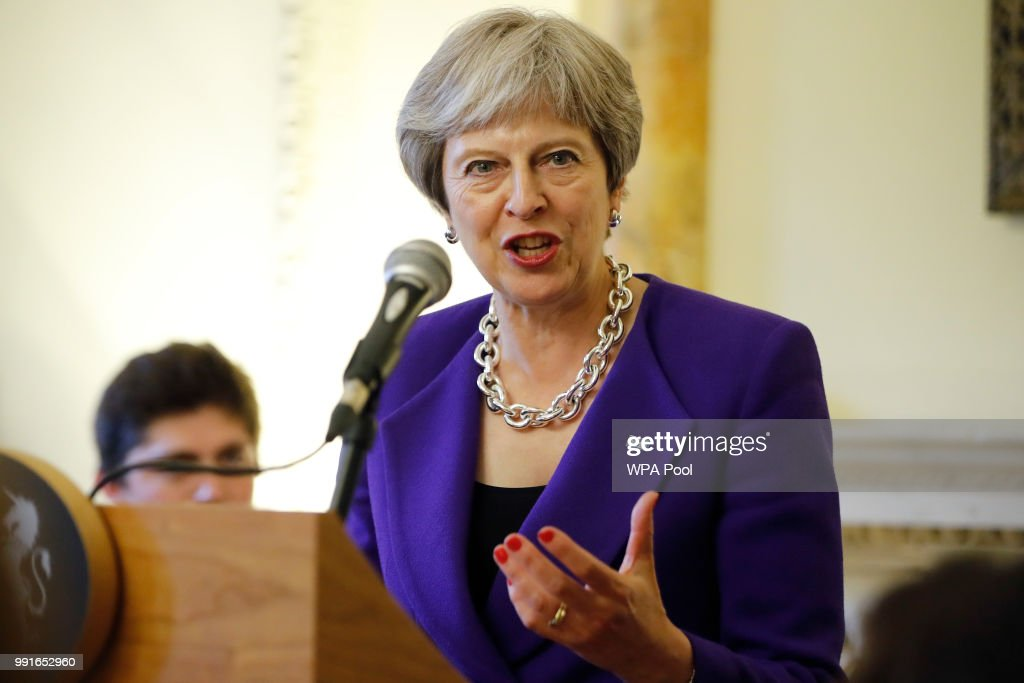 Prime Minister Theresa May speaks to assembled guests as she hosts a reception to mark the 70th Anniversary of the NHS at 10 Downing Street on July 4, 2018 in London, United Kingdom.