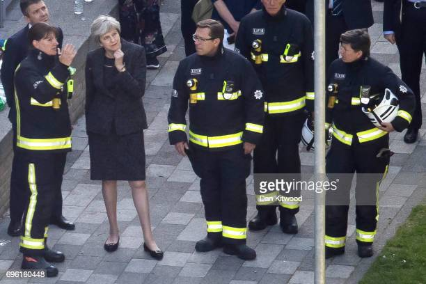 Prime Minister Theresa May speaks to Dany Cotton Commissioner of the London Fire Brigade with members of the fire service as she visits Grenfell...