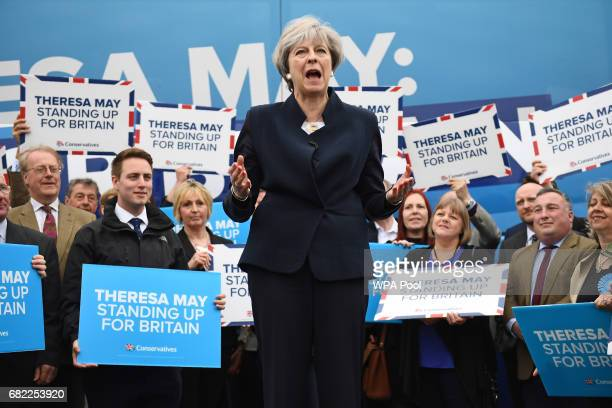 Prime Minister Theresa May speaks to party supporters in front of the Conservative party's general election campaign 'battle bus' at an airfield...