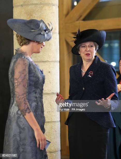 Prime Minister Theresa May speaks to Queen Mathilde of Belgium in Cloth Hall as they visit Market Square Ypres for an event that will tell the story...