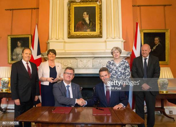 Prime Minister Theresa May stands with First Secretary of State Damian Green Democratic Unionist Party leader Arlene Foster DUP Deputy Leader Nigel...