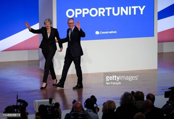 Prime Minister Theresa May stands with her husband Philip after she delivers her keynote speech on the final day of the Conservative Party Conference...