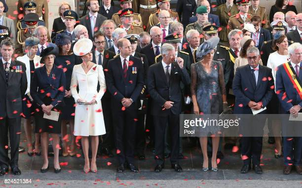 Prime Minister Theresa May the Duke and Duchess of Cambridge King Philippe and Queen Mathilde watch as the poppies fall from the roof of the Menin...