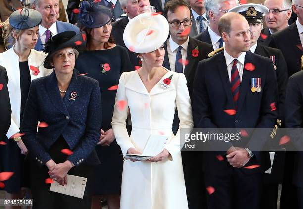 Prime Minister Theresa May the Prince William Duke of Cambridge and Catherine Duchess of Cambridge watch as the poppies fall from the roof of the...
