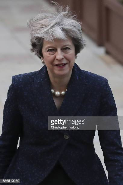 Prime Minister Theresa May walks across the concourse of Manchester Central at the start of day two of the Conservative Party Conference on October 2...