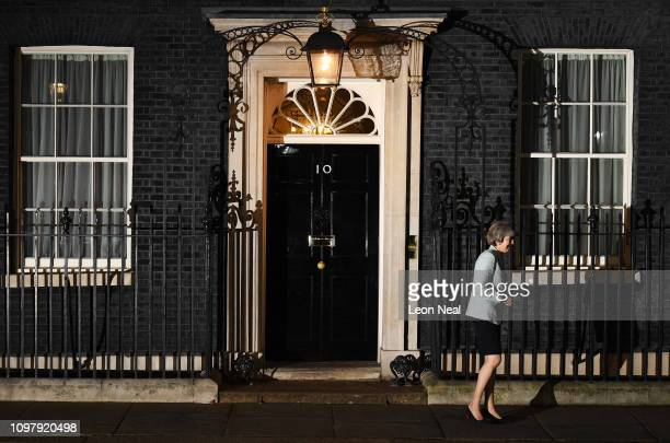 Prime Minister Theresa May walks down Downing Street to greet Joseph Muscat the Prime Minister of Malta as he arrives at Number 10 for a meeting on...