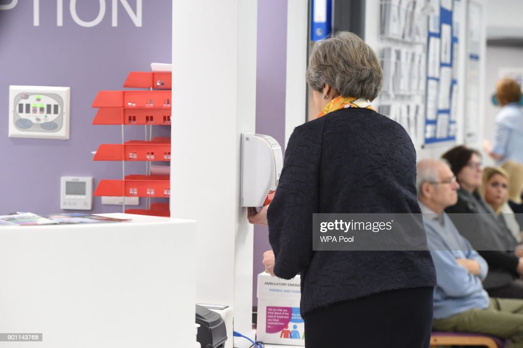 Prime Minister Theresa May washes her hands at Frimley Park Hospital on January 4, 2018 in Frimley, England.