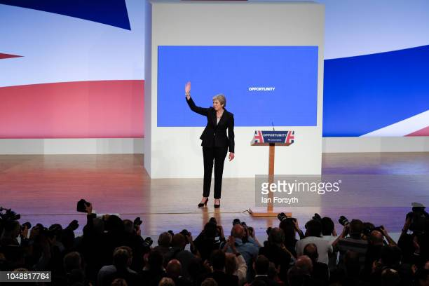 Prime Minister Theresa May waves to the audience after she delivers her keynote speech on the final day of the Conservative Party Conference in the...