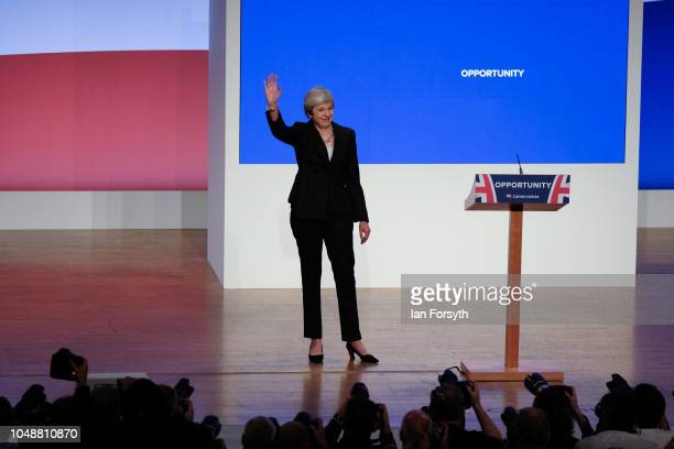 Prime Minister Theresa May waves to the crowd after she delivers her keynote speech on the final day of the Conservative Party Conference in the...