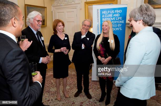 Prime Minister Theresa May with Adil Ray, Sir Billy Connolly, Jane Asher, Gerald Scarfe and Pamela Stephenson during a reception to mark 200 years...