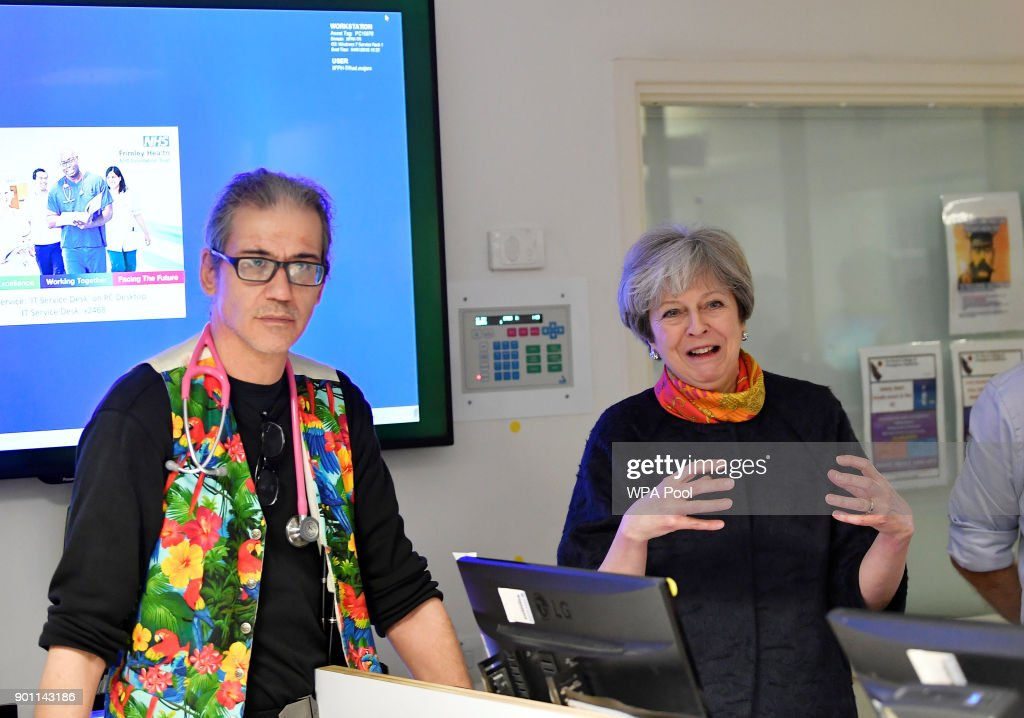 Prime Minister Theresa May (R) with consultant Nick Payne Emergency Sevices Director at Frimley Park Hospital on January 4, 2018 in Frimley, England.