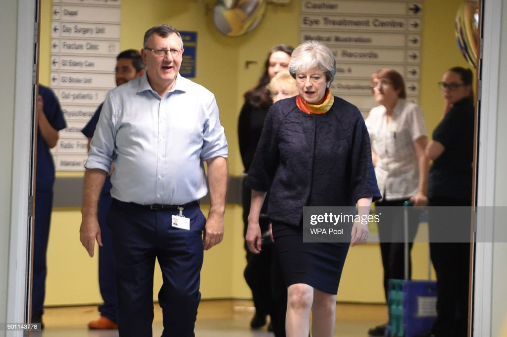 Prime Minister Theresa May (R) with Frimley Health CEO Sir Andrew Morris (L) at Frimley Park Hospital on January 4, 2018 in Frimley, England.