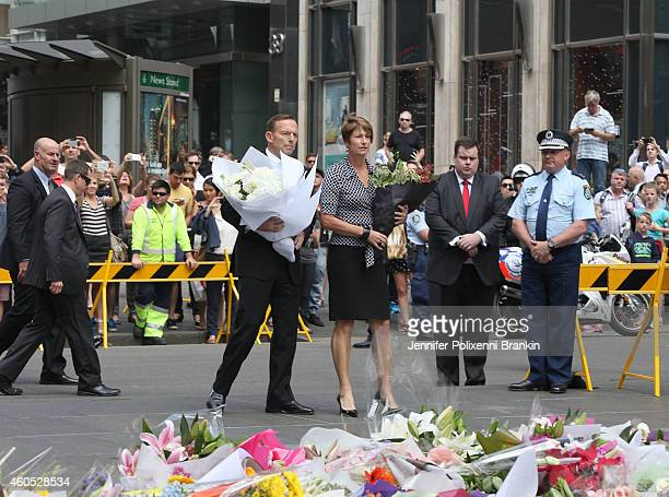 Prime Minister Tony Abbott and his wife place flowers as a mark of respect at Martin Place on December 16 2014 in Sydney Australia Sydney siege...