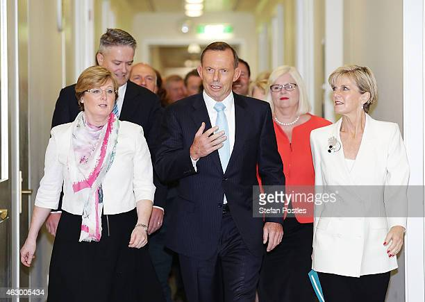 Prime Minister Tony Abbott and Minister for Foreign Affairs Julie Bishop walk to the party room at Parliament House on February 9 2015 in Canberra...