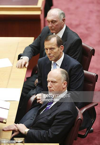Prime Minister Tony Abbott listens to the GovernorGeneral Quentin Bryce address the Senate and Representatives members on November 12 2013 in...