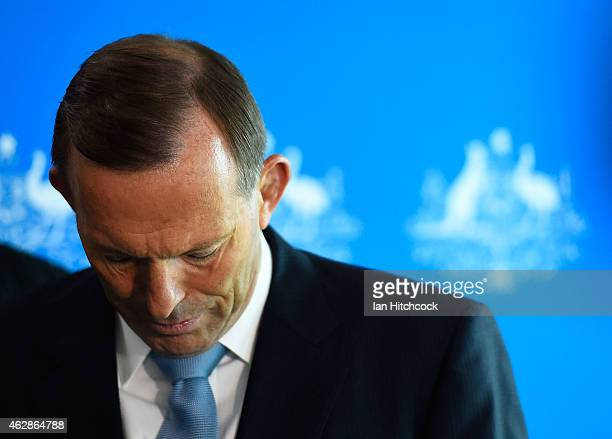 Prime Minister Tony Abbott looks down during a media conference at Townsville Airport on February 7, 2015 in Townsville, Australia.