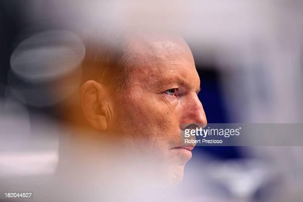 Prime Minister Tony Abbott looks on during the 2013 Blackwoods North Melbourne Grand Final Breakfast at Etihad Stadium on September 28 2013 in...
