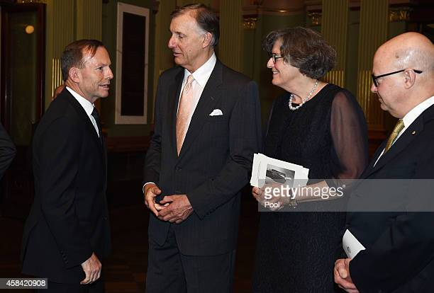 Prime Minister Tony Abbott pays his respects to Tony Whitlam Catherine Dovey and Kim Williams following the state memorial service for former...