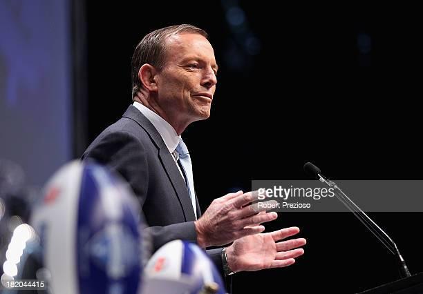 Prime Minister Tony Abbott speaks during the 2013 Blackwoods North Melbourne Grand Final Breakfast at Etihad Stadium on September 28 2013 in...