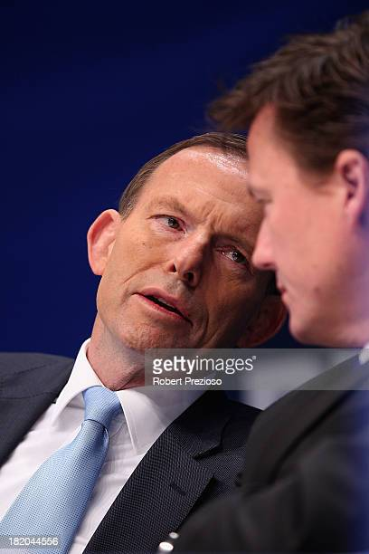 Prime Minister Tony Abbott speaks with North Melbourne President James Brayshaw during the 2013 Blackwoods North Melbourne Grand Final Breakfast at...