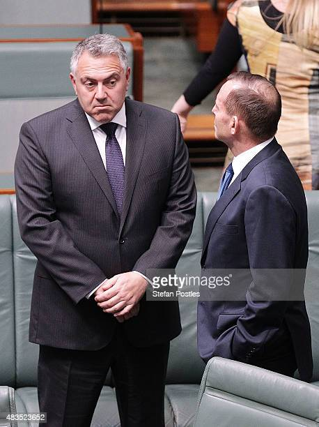 Prime Minister Tony Abbott speaks with Treasurer Joe Hockey in the House of Representatives at Parliament House on August 10 2015 in Canberra...