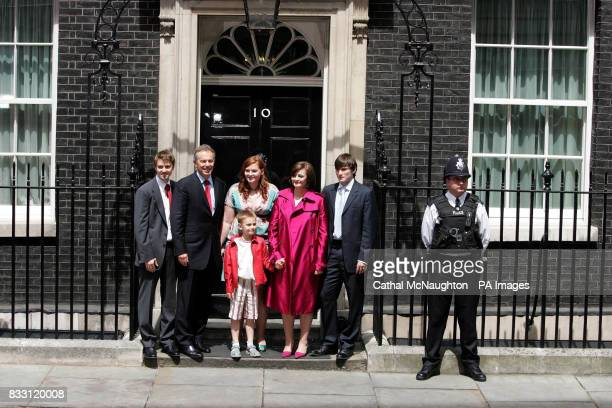 Prime Minister Tony Blair accompanied by his family Euan Kathryn Cherie Nicky Front row Leo pose on the steps of No10 as they leave Downing Street...