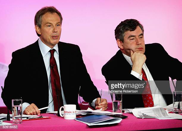 Prime Minister Tony Blair and Chancellor Gordon Brown look on at a press conference on Conservative spending and Labour Party budget plans on April...