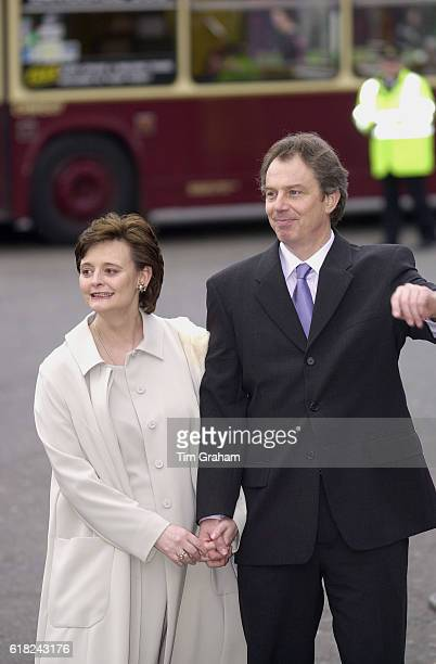Prime Minister Tony Blair and Pregnant Wife Cherie at Wesminster Abbey for Commonwealth service Politicians Political leaders Couple holding hands