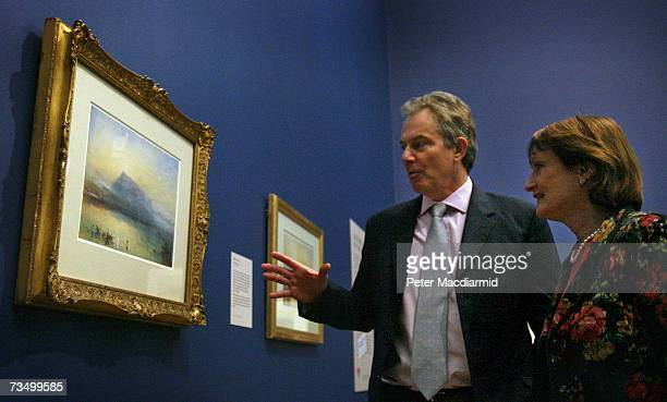 Prime Minister Tony Blair and Secretary of State for Culture Media and Sport Tessa Jowell look at Turner's The Blue Riga at the Tate Britain gallery...