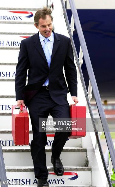 Prime Minister Tony Blair arrives back at Heathrow from the G8 Summit in Evian France after a marathon sevenday diplomatic mission which ended with a...