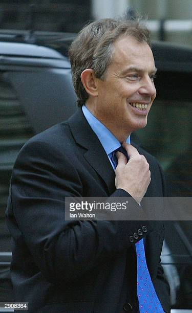 Prime Minister Tony Blair back at Downing Street January 28 2004 in London Blair is riding out a turbulent week in which his government narrowly...