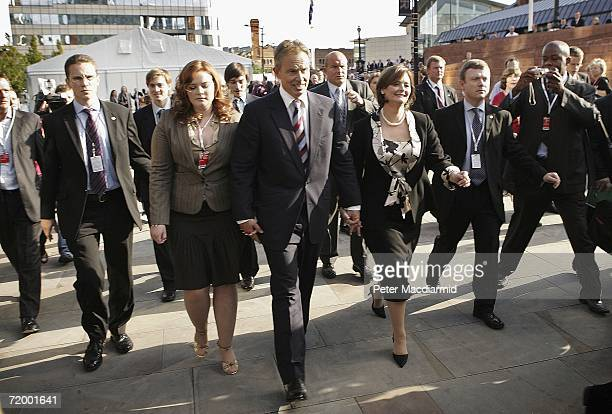 Prime Minister Tony Blair Cherie Blair and daughter Kathryn walk from conference after Blair made his keynote speech on September 26 2006 in...