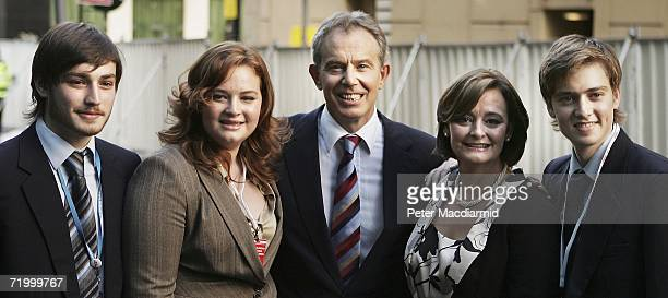 Prime Minister Tony Blair Cherie Blair daughter Kathryn and sons Euan and Nicky pose for photographers after he gave his keynote speech at the Labour...