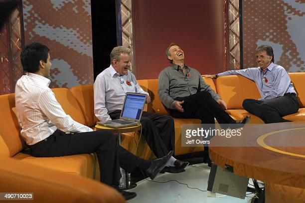 Prime Minister Tony Blair enjoys a joke while appearing on Football Focus with presenter Manish Bhasin and pundits / commentators John Motson and...