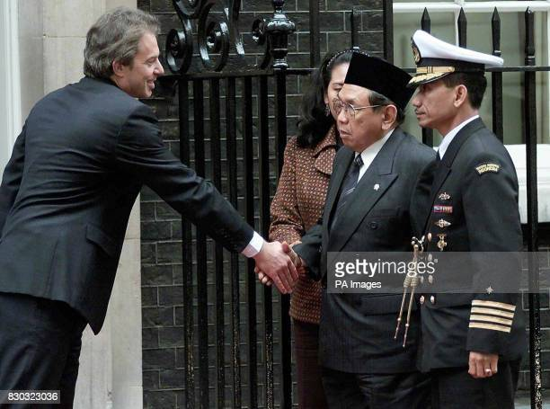 Prime Minister Tony Blair greets Indonesian President Abdurrahman Wahid on the doorstep of 10 Downing Street London