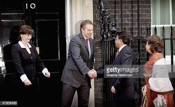 Prime Minister Tony Blair greets Pakistan President Pervez Musharraf outside 10 Downing St on December 6 2004 in London England During talks...