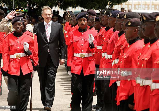 Prime Minister Tony Blair inspects a guard of honour on May 30 2007 in Freetown Sierra Leone Mr Blair is on a five day visit to meet with African...