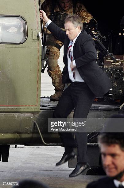 Prime Minister Tony Blair jumps down from a helicopter at Baghdad Airport after meeting with Iraqi leaders on December 17 2006 in Baghdad During...
