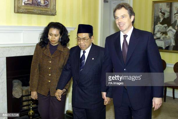 Prime Minister Tony Blair leads Indonesian President Abdurrahman Wahid and his daughter Zannuba at 10 Downing Street Mr Blair congratulated Wahid on...