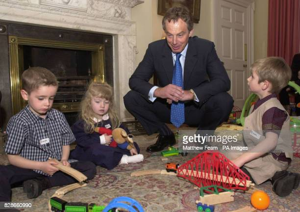 Prime Minister Tony Blair meets from left fouryearold Joseph Jackson from Leeds threeyearold Rebecca Grehan from Glasgow and fouryearold Adam Kaye...