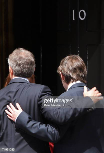 Prime Minister Tony Blair puts his arm round his son Nicky as he walks out of Downing Street for the last time on June 27 2007 in London Mr Blair...