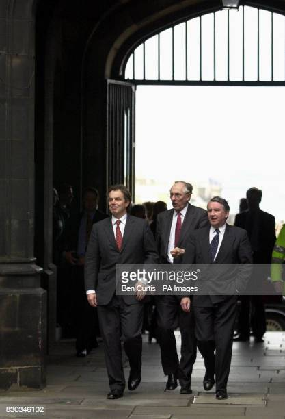 Prime Minister Tony Blair Scottish First Minister Donald Dewar and Presiding Officer Sir David Steel arriving at the Scottish Parliament buildings...